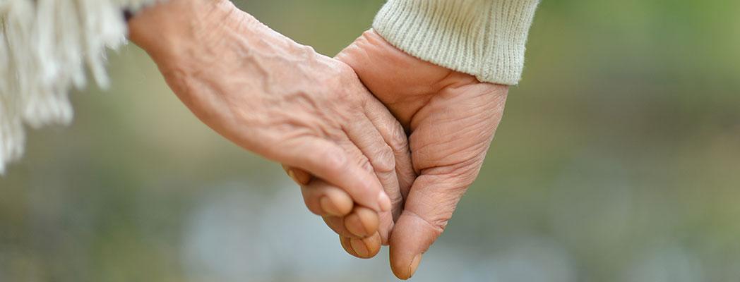 Older-couple-holding-hands---shutterstock_157019225