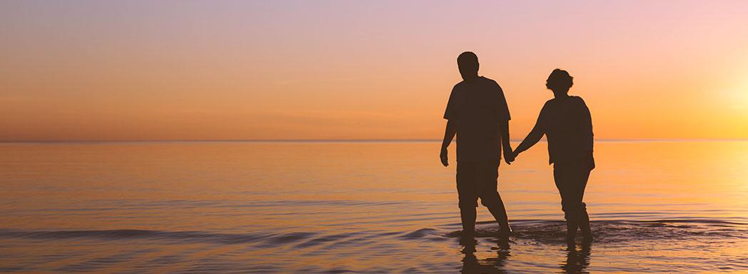 Older-couple-on-beach---shutterstock_217272238