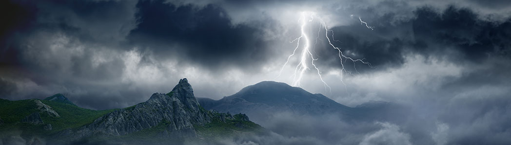 Lightning-in-dark-stormy-sky-in-mountains-shutterstock_158994251