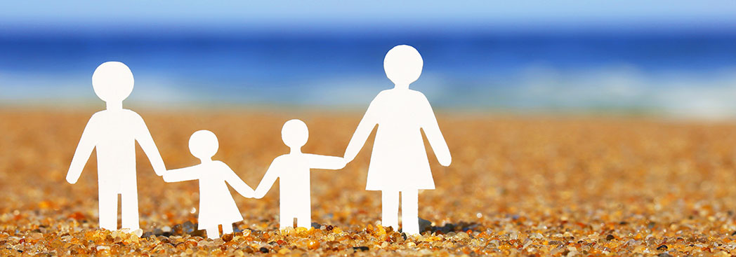 Family-(paper)-on-beach---shutterstock_196814333